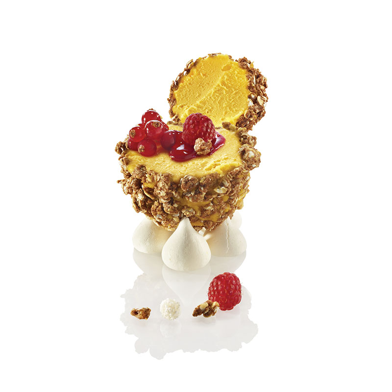 GRANOLA MYSTERY FILLED WITH MANGO SORBET, RED FRUITS HEART, RASPBERRY COULIS AND MERINGUE DROPS