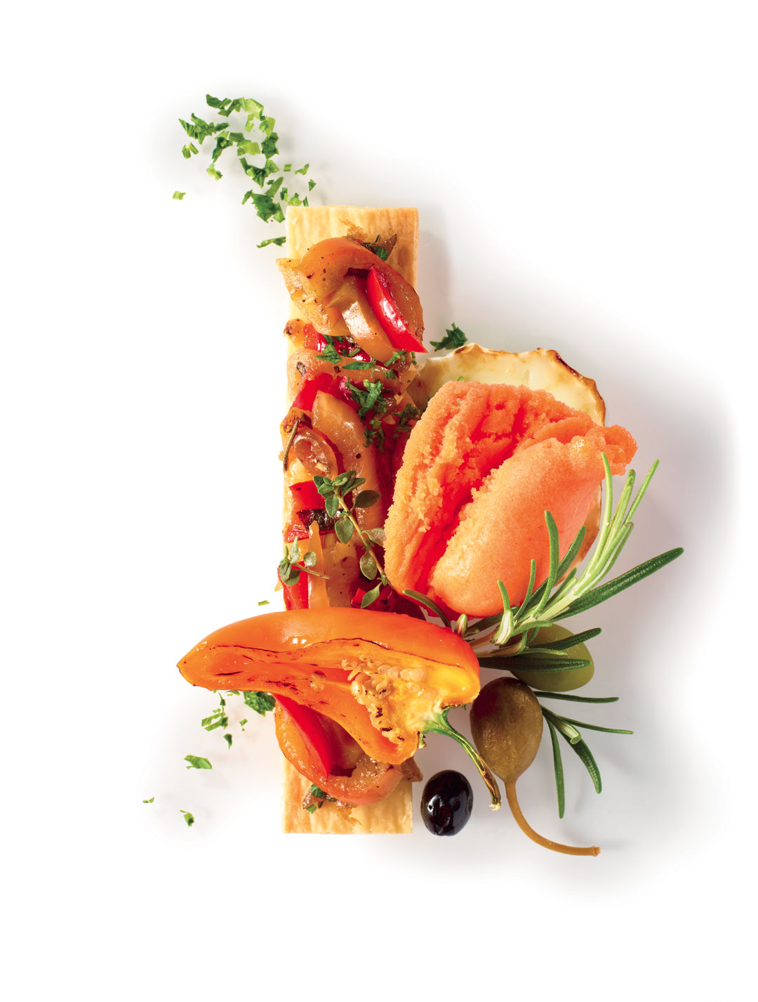 RED PEPPER SORBET, PEPPER PISSALADIÈRE, MELTED GOAT CHEESE, GRILLED PEPPERS, OLIVES, ROSEMARY AND PARSLEY