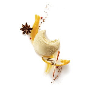RICE PUDDING ICE CREAM ON EXOTIC COULIS AND SPICES (CINNAMON, CARAWAY, TURMERIC, ROSE PEPP...